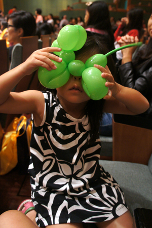 with a green balloon dog