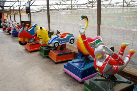 a long row of kiddy rides