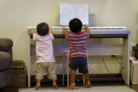 the boys trying to play some music