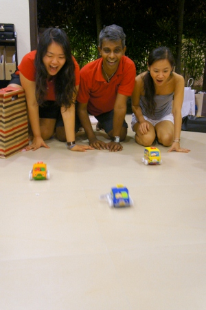big kids playing with toy cars