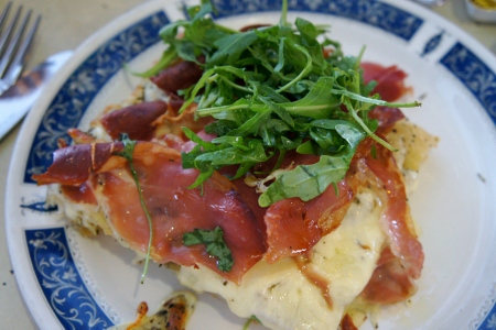 focaccia with ham, cheese and rocket leaves