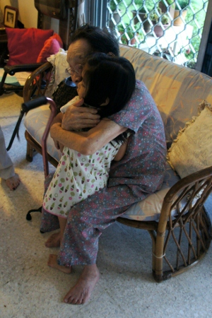 getting a big hug from great grandma