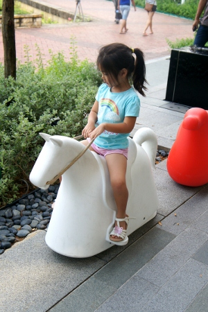 strange rocking horse outside