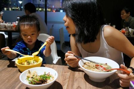 Fifi encouraging Adam to eat