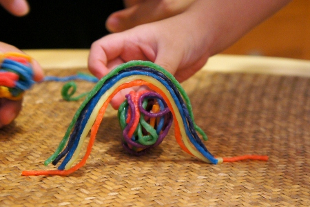 game where the Wikki Stix ball gets rolled under a rainbow