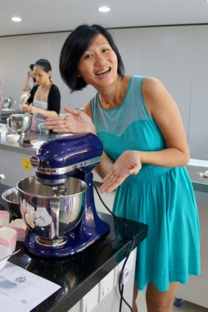 posing in a bimbotic manner with the KitchenAid