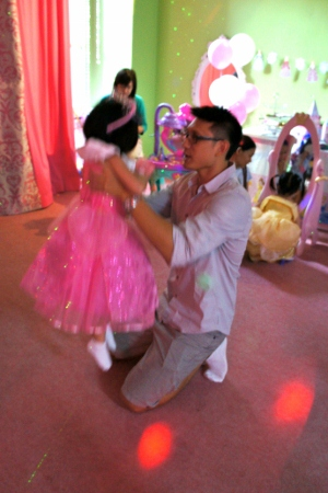Princess H dancing with her daddy
