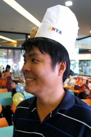 giant head trying to squeeze into a chef's hat