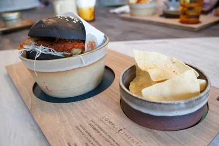 soft shell chili crab burger in a squid ink bun