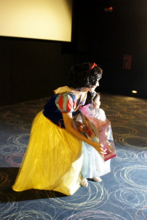 getting her prize from Snow White