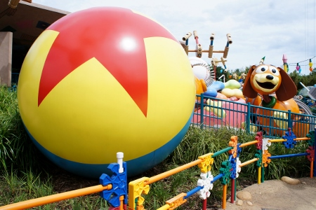 Pixar Ball and Slinky Dog Spin in the background