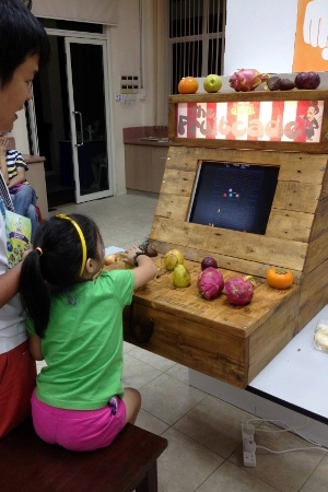 an arcade game with fruits as the controllers!