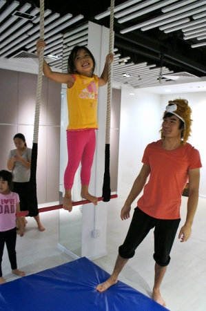 standing on the trapeze