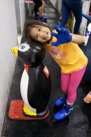 posing with her penguin skating aid