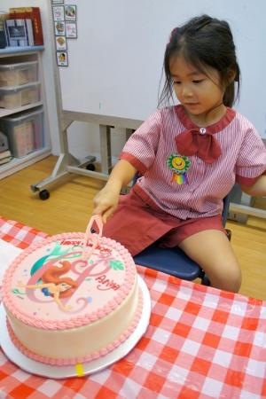 cutting her cake