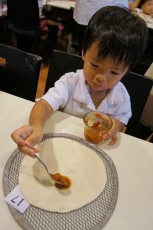 spreading the tomato paste