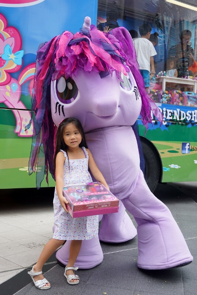 her dress matches the pony perfectly