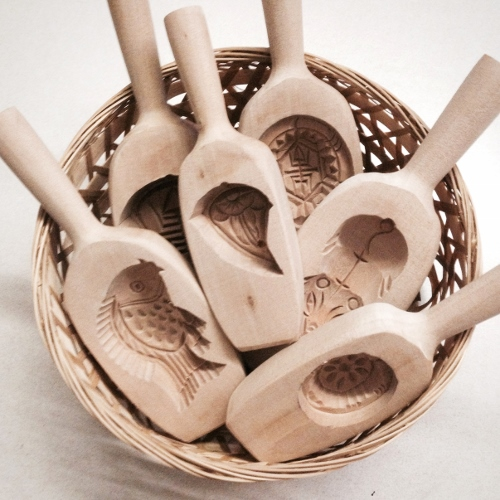 a basketful of wooden moulds