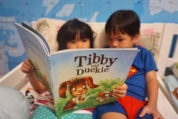 reading Tibby and Duckie to her brother