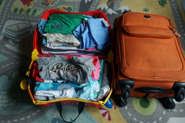 take another suitcase and fill with diapers/ milk powder/ books/ toys!