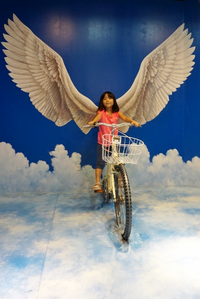 angel on a bike