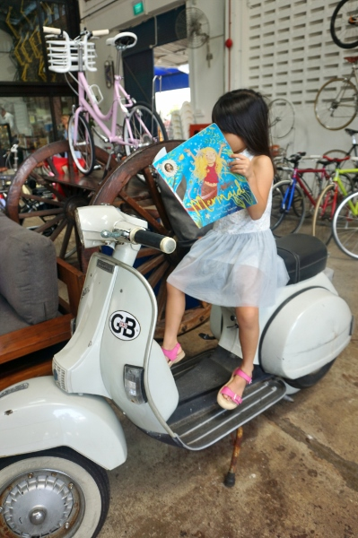 reading on a Vespa