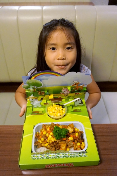 showing off her Garden Kid's Meal