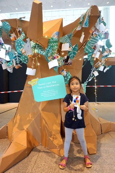 posing with her Tree of Resilience medal