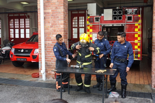putting on the fire jacket and other safety equipment